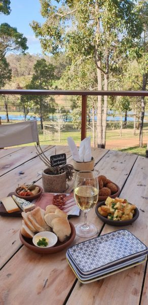 Tapas on wooden table in forest setting